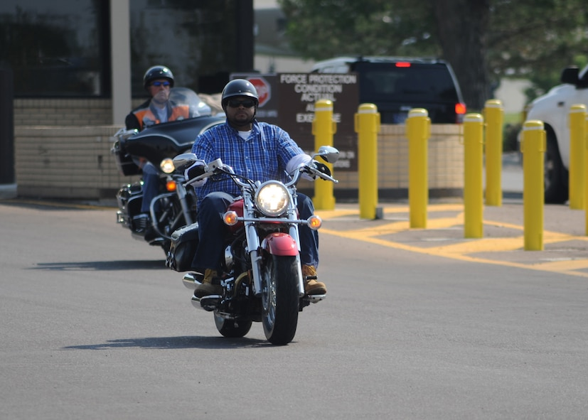 Brennan Stansberry, a Team Malmstrom dependent, drives off base as part of one of many 10-person groups taking part in the Rolling Thunder mentorship ride Aug. 27.  Rolling Thunder encouraged all motorcycle riders – Airmen and their dependents alike – to ride safely.  (U.S. Air Force photo/Senior Airman Cortney Paxton)