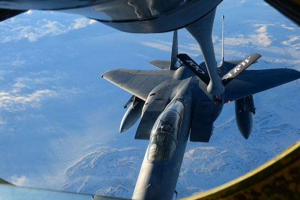 Members of a KC-135 Stratotanker crew refuel an F-15C Eagle over Iceland during a training mission Nov. 19, 2013. The 48th Air Expeditionary Group has been maintaining the North Atlantic Treaty Organization air surveillance and policing mission in Iceland since Oct. 28, 2013.