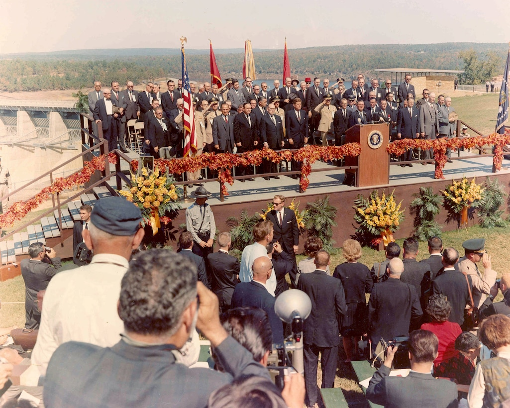 """View of platform during Presentation of the Colors and playing of the National Anthem [President John F. Kennedy attending dedication of Greers Ferry Dam]. Oct. 3, 1963."""" (photo by USACE Little Rock District)."""