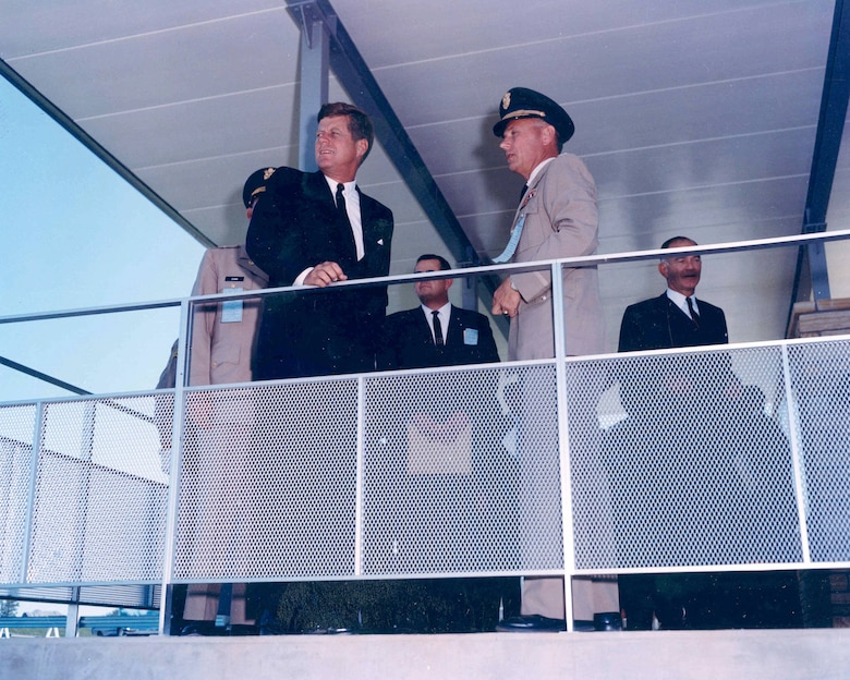 President John F. Kennedy views Greers Ferry Dam from the overlook with Colonel Charles D. Maynard, District Engineer, Little Rock District, U.S. Army Corps of Engineers, Oct. 3, 1963. (photo by USACE Little Rock District).