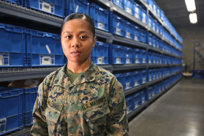 Corporal Diemtrinh Williams, a supply administration and operations specialist with 1st Supply Battalion, Combat Logistics Regiment 15, 1st Marine Logistics Group, stands inside a supply depot aboard Camp Pendleton, Calif., Nov. 21. Williams immigrated to America when she was seven years old and settled in Salina, Kan., which she now considers home. Even though the 21-year-old Marine has spent more than half her life in the states, she still remembers her roots and uses it to motivate herself and the Marines around her.