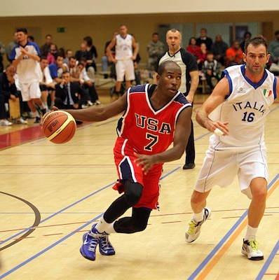2d Lt Mike Lyons (USAFA, CO) drives to the basket against Italy during the 2013 SHAPE International Basketball Tournament held at SHAPE (Mons), Belgium 24-30 November.  Italy narrowly defeats the US 57-55 in the opening round.