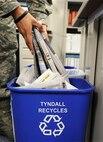 Team Tyndall Airman recycling Dec. 12. (U.S. Air Force photo illustration by Airman 1st Class Alex Echols)
