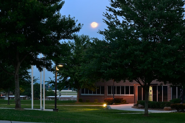 MCGHEE TYSON AIR NATIONAL GUARD BASE, Tenn. - The full moon rises above the tree tops on a still night at the I.G. Brown Training and Education Center's campus, June 22, 2013, outside the Smoky Mountains. Since 1968, men and women have brought the campus to life. (U.S. Air National Guard photo by Master Sgt. Kurt Skoglund/Released)