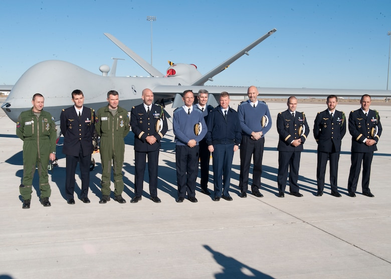 The newly- graduated French air force pilots and sensor operators stand with Colonel Andrew Croft, 49th Wing commander and Lt. Gen. Antoine Creux, French air force deputy chief of staff, in front of an MQ-9 Reaper at Holloman Air Force Base, N.M., Nov. 26. The French air force worked in collaboration with Holloman AFB to graduate six student pilots and sensor operators from the 16th Training Squadron.  The students became the first-ever French air force members to learn the MQ-9 Reaper system, and their landmark graduation will mark the beginning of future coalition efforts between France and the U.S. to better utilize Remotely Piloted Aircraft across the world. Creux visited Holloman AFB both to take part in the graduation ceremony, and to tour Holloman AFB's MQ-9 training facilities. (U.S. Air Force phot by Airman 1st Class Daniel E. Liddicoet/Released)