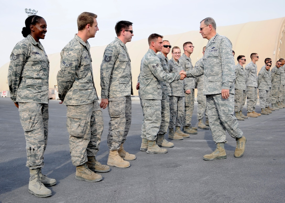 Gen. William M. Fraser III greets Airmen assigned to the 8th Expeditionary Air Mobility Squadron during a visit to the 379th Air Expeditionary Wing in Southwest Asia, Nov. 29, 2013. The general's visit was to share the Thanksgiving holiday with deployed troops and thank them for their service and sacrifice. Fraser is the commander of U.S. Transportation Command. (U.S. Air Force photo/Senior Airman Bahja J. Jones)