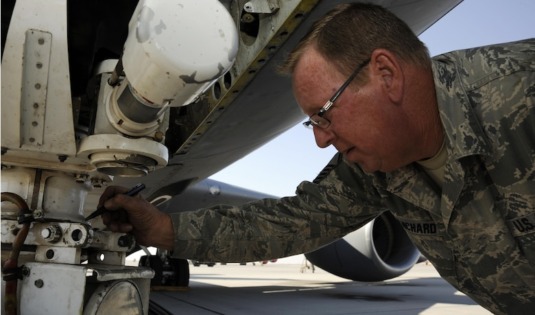 Master Sgt. Timothy Blanchard marks the nose wheel steering travel during an operations check after reinstallation on a KC-135 Stratotanker Nov. 26, 2013, at the 379th Air Expeditionary Wing in Southwest Asia. The aero repair shop has performed more than 350 major aircraft repairs this year, saving the Air Force money in maintenance and estimated shipping costs. Blanchard is a 379th Expeditionary Maintenance Squadron repair and reclamation technician.