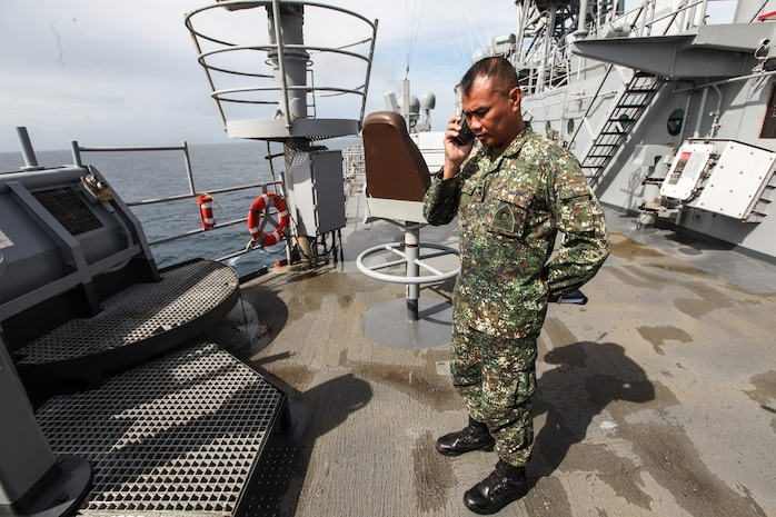 First Lt. Jose Eugenio E. Eclavia, security officer for the Philippine Navy Ship Gregorio Del Pilar, Patrol Force 15, and a native of IloIlo City, Republic of the Philippines, talks to the executive officer of his ship from the deck of USS Germantown (LSD 42), Nov. 21. Eclavia is a liaison officer from the Philippine Marine Corps working with the 31st Marine Expeditionary Unit to help coordinate disaster relief efforts in support of Operation Damayan. The 31st MEU and the ships of Amphibious Squadron are capable of delivering robust air, ground, and maritime transportation; medical and dental health services; distribution services for food, water and other supplies; and engineering assets for infrastructure repair and road clearance. The 31st MEU is deployed at the request of the government of the Republic of the Philippines and in coordination with Joint Task Force 505 personnel and the U.S. Agency for International Development.