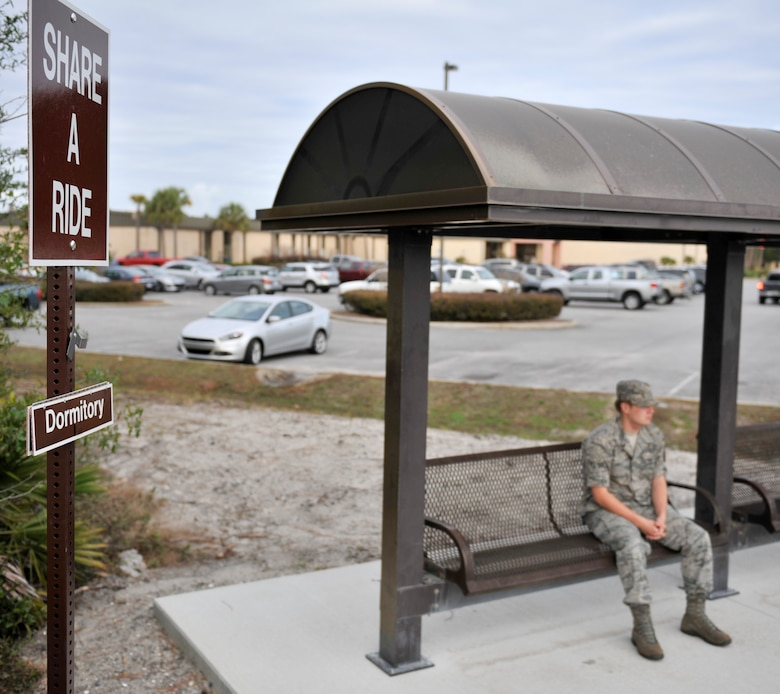 An Airman waits for a ride outside the 1st Special Operations Medical Group on Hurlburt Field, Fla., Dec. 3, 2013. The Share a Ride program was recently established to help Airman without vehicles get to various places across the base. (U.S. Air Force photo/Airman 1st Class Jeff Parkinson)