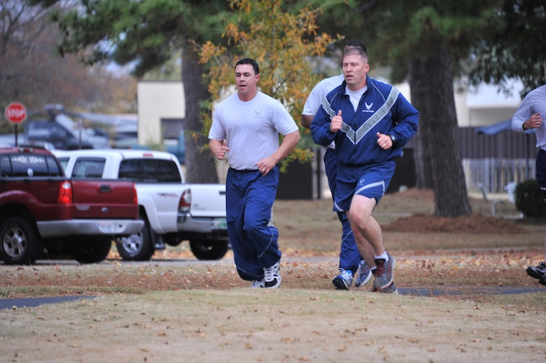 Tech. Sgt. Steven Pierce Jr. and Master Sgt. Shane Merillar, both from Air Force Legal Operation Agency and attending the Senior NCO Professional Development Seminar, run during a physical training session at Maxwell Air Force Base, Nov. 21. The annual course also serves as the lead up to the senior NCO induction ceremony. (U.S. Air Force photo by Airman 1st Class William Blankenship)