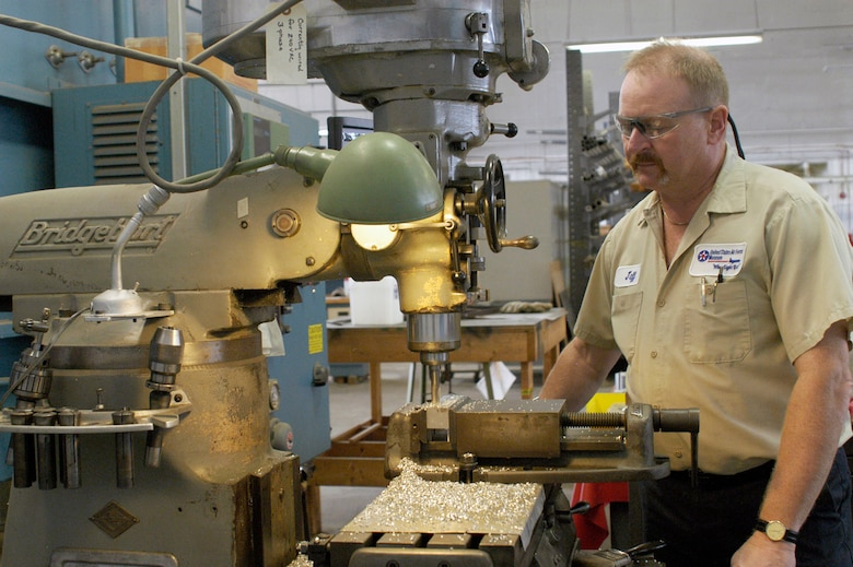 DAYTON, Ohio -- Jeff Helman volunteers as a machinist in addition to running his family's machine and tool business. (U.S. Air Force photo)