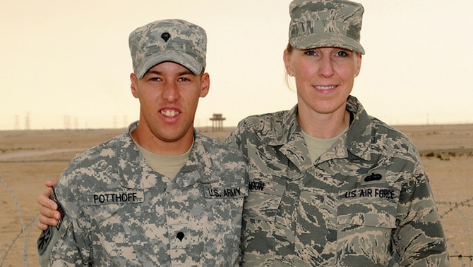 Master Sgt. Shanda Moon and her nephew, Army Spc. Alec Potthoff pose for a photo at their base in Southwest Asia where both are deployed. Moon is the executive assistant to the Command Chief, Air Force Central Command, and Potthoff is assigned to the 1st Battalion, 43rd Air Defense Artillery.  Moon and her nephew, Potthoff, recently had an unexpected reunion in the dining facility after more than five years apart.