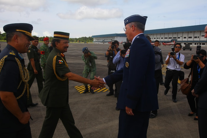 U.S. Air Force Maj. Gen. Paul H. McGillicuddy greets the Sultan of Brunei Haji Hassanal Bolkiah Mu'izzaddin Waddaulah as they begin tours of the U.S. Air Force C-17 Globemaster III, Marine MV-22B Osprey and KC-130J Super Hercules aircraft Dec. 3 at Rimba Air Base, Brunei, during the 4th Biennial Brunei Darussalam International Defense Exhibition and Conference. The five-day event includes displays and demonstrations of military equipment, with the theme of bridging the capability gap. BRIDEX 13 is an opportunity for communication and cooperation with regional partners and allies, builds strong multilateral relationships and enhances preparedness for disasters and other contingency operations. U.S. participation in BRIDEX 13 demonstrates cooperative engagement with Brunei and continued commitment to regional security and stability in the Asia-Pacific region. McGillicuddy is chief of staff, Pacific Air Force.