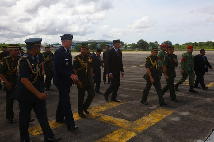 U.S. Air Force Maj. Gen. Paul H. McGillicuddy walks with the Sultan of Brunei Haji Hassanal Bolkiah Mu'izzaddin Waddaulah as they begin tours of the U.S. Air Force C-17 Globemaster III, Marine MV-22B Osprey and KC-130J Super Hercules aircraft Dec. 3 at Rimba Air Base, Brunei, during the 4th Biennial Brunei Darussalam International Defense Exhibition and Conference. The five-day event includes displays and demonstrations of military equipment, with the theme of bridging the capability gap. BRIDEX 13 is an opportunity for communication and cooperation with regional partners and allies, builds strong multilateral relationships and enhances preparedness for disasters and other contingency operations. U.S. participation in BRIDEX 13 demonstrates cooperative engagement with Brunei and continued commitment to regional security and stability in the Asia-Pacific region. McGillicuddy is chief of staff, Pacific Air Force.