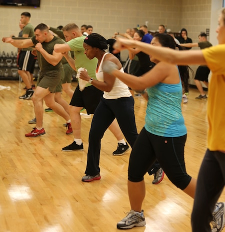 Students at Wallace Creak Fitness Center's Cardio Kickboxing class, including Lee Golden, a environmental protection specialist aboard Marine Corps Base Camp Lejeune,  perform a variety of fast paced kicks and jabs, Dec. 2. The Cardio Kickboxing class takes place Monday's at 11:30 a.m. as well as Tuesday's and Thursday's at 9:30 a.m.