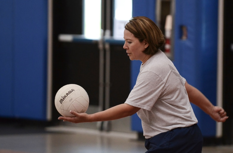 """Rena Banes, 36th Maintenance Group first sergeant, serves the ball during a volleyball game Dec. 2, 2013, at the Coral Reef Fitness Center on Andersen Air Force Base, Guam. The """"ALS versus Shirts"""" volleyball game between Airman Leadership School students and first sergeants is an Air Force-wide tradition. The 36th Wing first sergeants defeated the ALS students, 3-1 sets. (U.S. Air Force photo by Senior Airman Marianique Santos/Released)"""