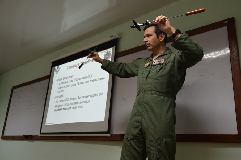 Lt. Col. Eric Perlman, an F-16 instructor pilot with the Air Force Reserve, leads a classroom briefing for U.S. and Dominican Republic airmen as part of an exercise to combat illegal drug trafficking Dec. 3, 2013, over the skies of the Caribbean. The exercise is part of the Sovereign Skies Expansion Program, an initiative between the U.S., Colombian, and Dominican Republic air forces to share best-practices on procedures to detect, track and intercept illegal drugs moving north from South America. (U.S. Air Force photo by Capt. Justin Brockhoff/Released)