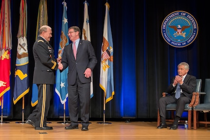 Chairman of the Joint Chiefs of Staff Gen. Martin E. Dempsey shakes hands with outgoing Deputy Defense Secretary Ash Carter during a farewell ceremony for Carter at the Pentagon, Dec. 2, 2013.  Photo by Mass Communication Specialist 1st Class Daniel Hinton.