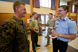 Sgt. Greg Wubben, civil affairs non-commissioned officer with 1st Civil Affairs Group, from Ridgefield, Wash., talks with an Air Force cadet while coalition forces visited the Timaru Christian School during exercise S