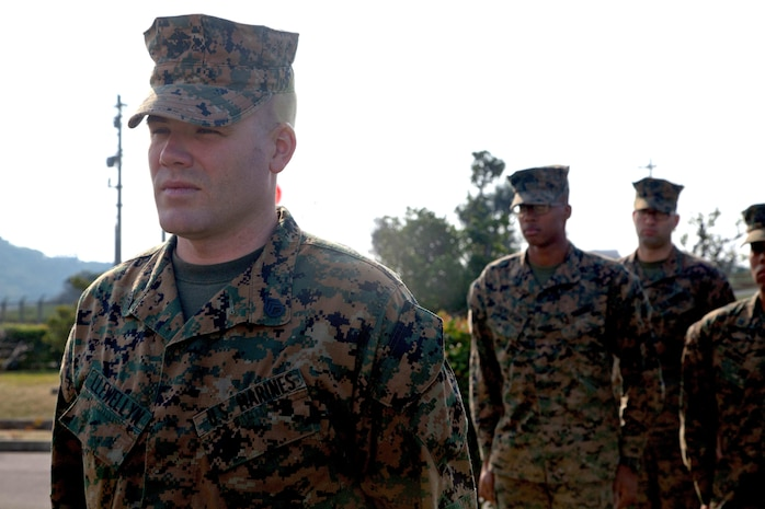 Staff Sgt. Gordon L. Llewellyn stands before a formation while his Navy and Marine Corps Achievement Medal citation is read Dec. 5 at the Ie Shima Training Facility. Llewellyn received the award due to his courageous actions and quick thinking during the rescue of a teenaged girl after she was involved in a car accident Aug. 26. Llewellyn is the staff noncommissioned officer in charge of Ie Shima Training Facility and currently assigned to G-3, operations, Range Control, Marine Corps Base Camp Smedley D. Butler.
