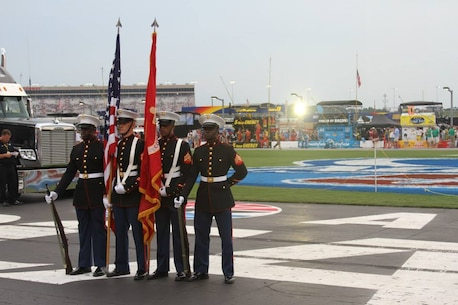 The Recruiting Station Atlanta color guard presents the colors at the AdvoCare 500 at Atlanta Motor Speedway in Hampton, GA, Sept. 1. The AdvoCare 500 is a NASCAR Sprint Cup Series stock car race held at AMS during Labor Day weekend. Recruiting Station Atlanta is a part of 6th Marine Corps District, Eastern Recruiting Region, Marine Corps Recruiting Command. (U.S. Marine Corps photo by Cpl. Courtney G. White/Released)