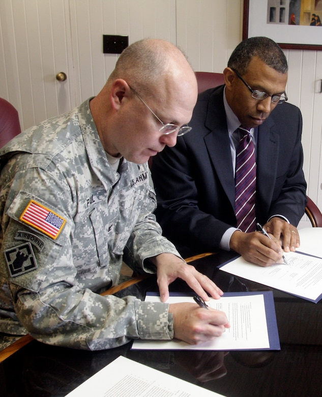 Little Rock District Commander Col. Courtney W. Paul and University of Pine Bluff Chancellor Laurence B. Alexander sign a Memorandum of Understanding for the advancement of Science, Technology, Engineering, Mathematics enrichment programs to increase the number of well-prepared underrepresented minority STEM graduates for careers in STEM professions.