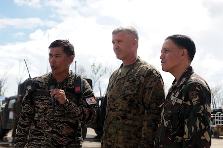 Brig. Gen. Paul Kennedy, center, Philippine Navy Capt. Roy V. Trinidad, left, and Philippine Army Col. Emmanuel Cacdac conduct a media interview Nov. 24 at Tacloban airport. The military officers discussed transition to long-term recovery operations after successful Government of the Philippines-led emergency relief efforts. U.S. forces are beginning to redeploy due to decreasing requirements for U.S. military capabilities. Kennedy is the commanding general of 3rd Marine Expeditionary Brigade, currently in support of Joint Task Force 505. Trinidad is the task-group airport commander with Joint Headquarters Staff Operations. Cacdac is the deputy task force commander, Yolanda.