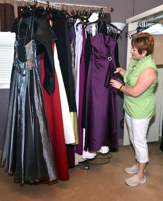 Judy Slisik, Command Chief Master Sgt. Slisik's wife, looks at a dress in the Cinderella's Closet at Andersen Air Force Base, Guam, Dec. 3, 2013. The Cinderella's Closet houses approximately 250 dresses available in a variety of sizes, colors and lengths and can be borrowed by military members or their families for any formal occasion. (U.S. Air Force by Airman 1st Class Mariah Haddenham/Released)