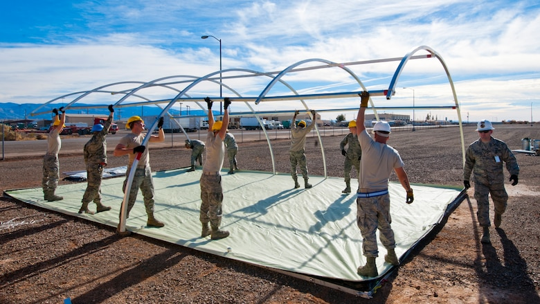 49th Materiel Maintenance Squadron structures Airmen work to construct a Small Shelter System at Holloman Air Force Base, N.M., Dec. 2. The Airmen trained on building fully-ventilated structures such as the SSS to maintain skills needed during construction in deployed environments. The 49th MMS accomplishes the mission by sending large, all-inclusive packaged equipment to deployed locations or to areas impacted by natural disasters. (U.S. Air Force photo by Senior Airman Daniel E.Liddicoet/Released)