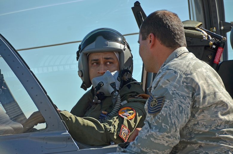 A Dominican Republic air force pilot and maintenance crew chief conduct pre-flight checks of an A-29 Super Tucano during an exercise to combat illegal drug trafficking over the skies of the Caribbean Dec. 3, 2013. The exercise is part of the Sovereign Skies Program, an initiative between the U.S., Colombian, and Dominican Republic air forces to share best-practices on procedures to detect, track and intercept illegal drugs moving north from South America. Since the program's inception, the number of aircraft suspected to traffic drugs through the Dominican Republic dropped from more than 100 annually to nearly zero. (U.S. Air Force photo by Capt. Justin Brockhoff/Released)