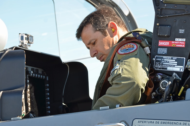 Lt. Col. Eric Perlman, a U.S. Air Force F-16 instructor pilot, prepares to ride in the back seat of a Dominican Republic air force A-29 Super Tucano as part of an exercise to combat illegal drug trafficking Dec. 3, 2013. The exercise is part of the Sovereign Skies Program, an initiative between the U.S., Colombian, and Dominican Republic air forces to share best-practices on procedures to detect, track and intercept illegal drugs moving north from South America. Since the program's inception, the number of aircraft suspected to traffic drugs through the Dominican Republic dropped from more than 100 annually to nearly zero. (U.S. Air Force photo by Capt. Justin Brockhoff/Released)