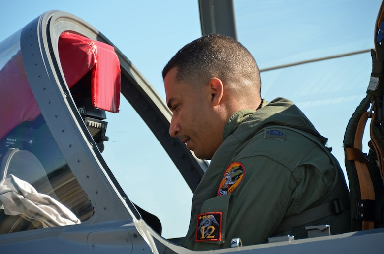 A Dominican Republic air force A-29 pilot conducts a pre-flight inspection of his aircraft during an exercise to combat illegal drug trafficking over the skies of the Caribbean Dec. 3, 2013. The exercise is part of the Sovereign Skies Program, an initiative between the U.S., Colombian, and Dominican Republic air forces to share best-practices on procedures to detect, track and intercept illegal drugs moving north from South America. Since the program's inception, the number of aircraft suspected to traffic drugs through the Dominican Republic dropped from more than 100 annually to nearly zero. (U.S. Air Force photo by Capt. Justin Brockhoff/Released)
