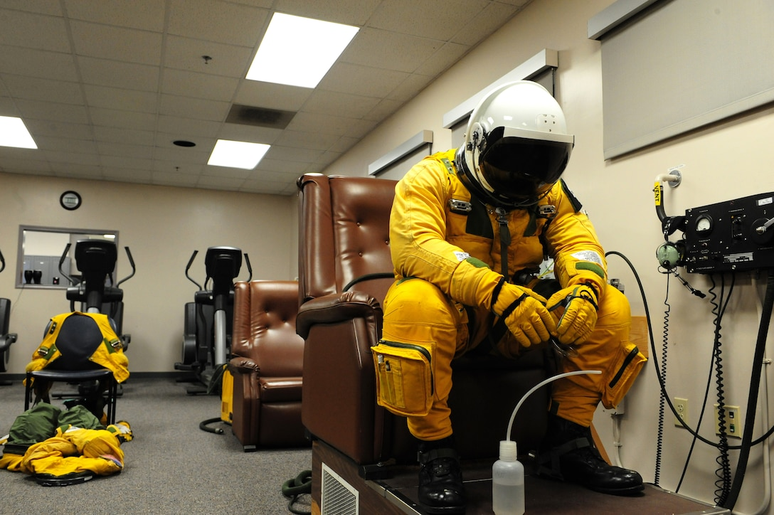 Maj. Geoffrey, 1st Reconnaissance Squadron U-2 pilot, mentally prepares for his upcoming U-2 flight Dec. 3, 2013, at Beale Air Force Base Calif. U-2 pilots undergo a rigorous pre-flight schedule to ensure themselves and their full pressure suits are able to perform under extreme conditions during high altitude flights. (U.S. Air Force photo by Airman 1st Class Bobby Cummings/Released)