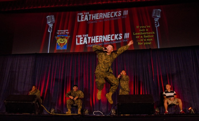"Lance Cpl. Lee Whisenant, a radio repairman from 1st Battalion, 12th Marine Regiment, and native of Pigeon Forge, Tenn., sings ""Ice Ice Baby."" Comedians Mike Epps and Tom Green, rapper Big Mike and performance group Purrfect Angelz, were featured in the tour, which is sponsored by the Single Marine Program at Headquarters Marine Corps. All active-duty service members aboard MCB Hawaii were welcome to watch the performance. (U.S. Marine Corps photo by Kristen Wong)"