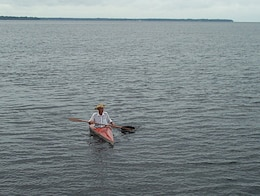 "Noble Enge ""at home"" in his beloved kayak during a 10-mile freshwater trip from the Shands Bridge to his house in Switzerland on the St. Johns River in 2003."