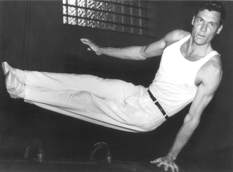 Though Enge contracted polio at age three and wore a heavy brace for the rest of his life, he never let it hold him back. He won many trophies and medals as a member of the University of Florida gymnastics team.