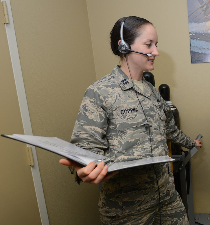 U.S. Air Force Capt. Margaret Coppini, 366th Aerospace Medicine Squadron aerospace and operational physiology flight commander reads Reduced Oxygen Breathing Device training instructions, Nov. 18, 2013 at Mountain Home AFB, Idaho. Reading the instructions are standard operating procedures before the start of each training mission. (U.S. Air Force photo/Tech Sgt. JT May III/RELEASED)