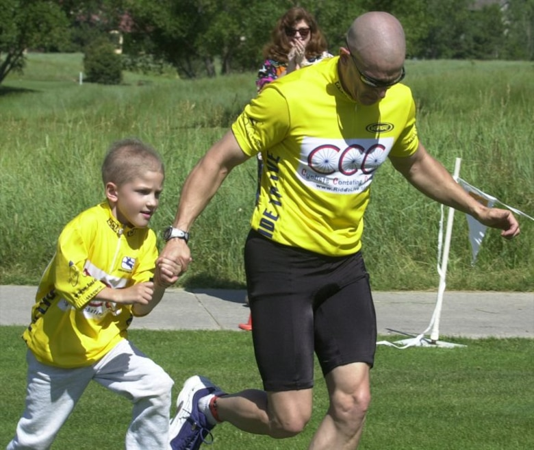 Capt. Eric Miller, 140th Medical Group, Colorado Air National Guard, began participating in triathlons with his son, Garrett, who was left visually impaired after he underwent surgery for a medulloblastoma malignant brain tumor at the age of five. (Photo courtesy of Capt. Eric Miller)