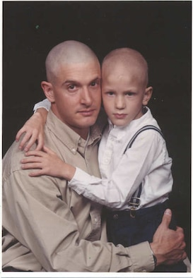 Capt. Eric Miller, 140th Medical Group, Colorado Air National Guard, with his son, Garrett, after he was diagnosed with a medulloblastoma malignant brain tumor at the age of five. (Photo courtesy of Capt. Eric Miller)