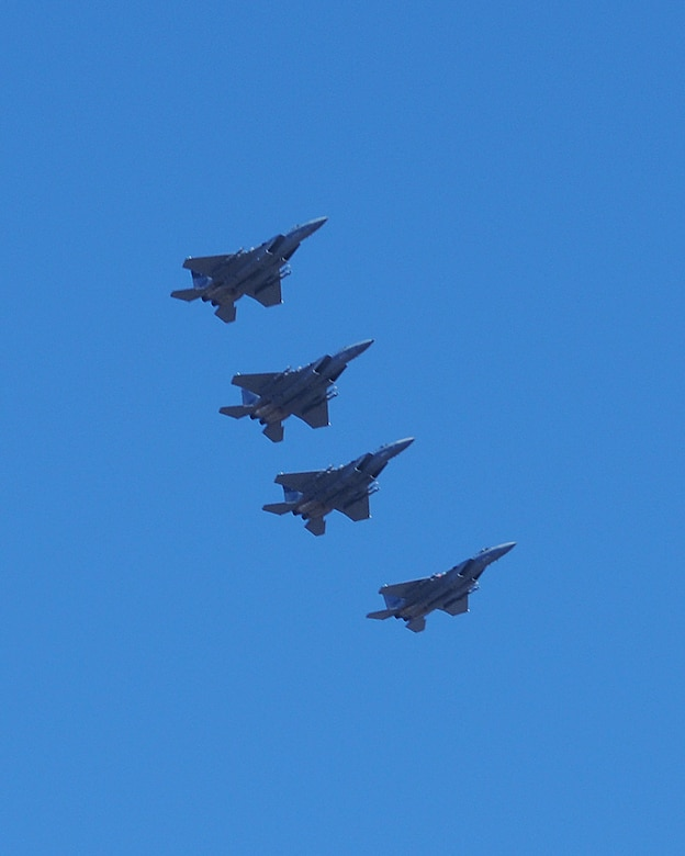 Four F-15Cs from the 144th Fighter Wing, Fresno, Calif., fly over the skies of Klamath Falls Dec. 4, 2013. The 173rd Fighter Wing is teaming up with the 144th to increase the number of students trained in order to meet an increased demand for F-15 pilots at the 144th. (U.S. Air National Guard photo by Master Sgt. Jennifer Shirar/released)