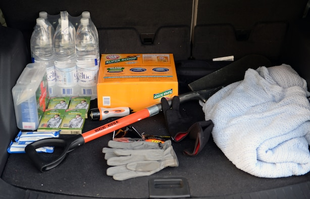 SPANGDAHLEM AIR BASE, Germany—A driver stocks the trunk of his car with safety supplies in preparation for the upcoming winter months Dec. 6, 2013. Some of the items include: a shovel, kitty litter, thermal blankets, water, hand warmers and a flashlight. (U.S. Air Force photo by Senior Airman Alexis Siekert)