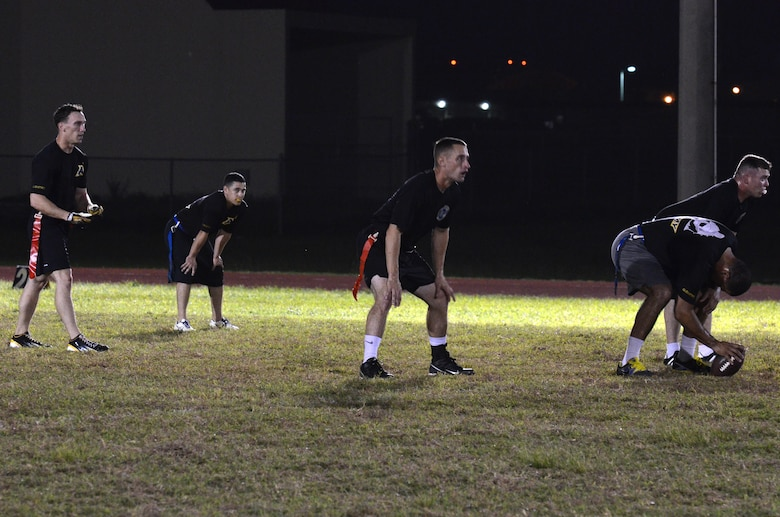 Players from 94th Army Air and Missile Defense Command prepare to play intramural flag football Dec. 4, 2013 on Andersen Air Force Base, Guam. 94th AAMDC practiced with Helicopter Sea Combat Squadron 25 to prepare for future games. (U.S. Air Force photo by Airman 1st Class Mariah Haddenham/Released)