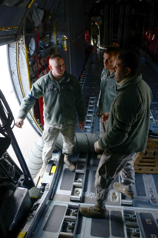 Senior Airman Robert DiMauro and Senior Airman Zachery Savluk, both crew chiefs assigned to the 103rd Airlift Wing, receive training from Tech. Sergeant Terrance Jones from the Kentucky Air National Guard, aboard a C-130H Hercules assigned to the 103rd Airlift Wing.  Instructors from the active duty Air Force are working with Airmen from the Kentucky and Minnesota Air National Guard to train maintainers at the Bradley Air National Guard Base.  (U.S. Air National Guard photo by Senior Airman Jennifer Pierce)
