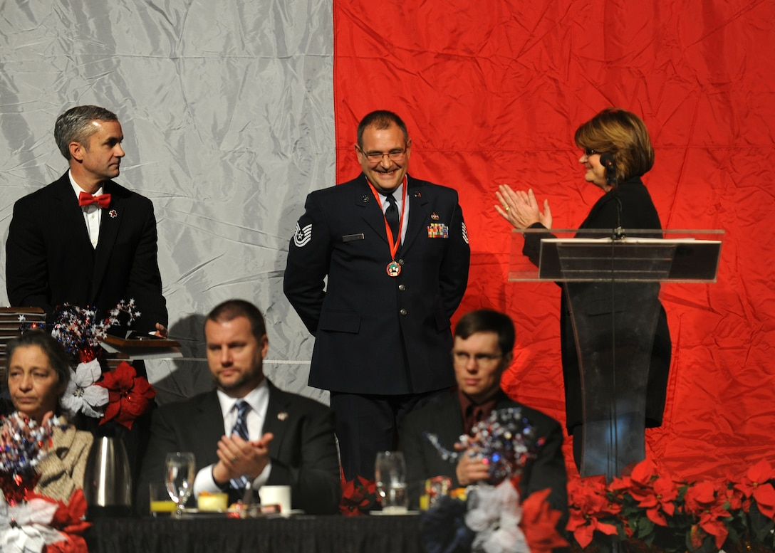 New York Air National Guard Tech. Sgt. Brian Matthews recieves the Red Cross Real Hero award at the OnCenter in Syracuse on 4 December 2013.  Matthews was given the award for his heroic actions in helping to rescue a neighbor whos home was on fire earlier in the year. (New York Air National Guard photo by Tech. Sgt. Jeremy M. Call/Released)