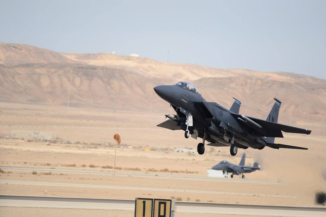 An F-15E Strike Eagle departs on a combat mission during the Blue Flag exercise at Uvda Air Force Base, Israel, Nov. 26, 2013. Blue Flag was a combined aerial warfare exercise to improve operational capability, combat effectiveness, understanding and cooperation between the U.S., Israel, Greece and Italy Nov. 24-28.  (U.S. Air Force photo by Master Sgt. Lee Osberry/Released)