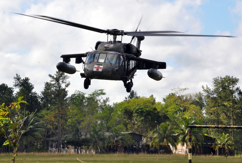 A UH-60 Blackhawk helicopter assigned to Joint Task Force-Bravo's 1-228th Aviation Regiment lifts off from Mocoron, Honduras, to conduct a medical evacuation (MEDEVAC) of a six-week old infant in the remote village of Auka, Dec. 3, 2013.  JTF-Bravo personnel successfully conducted the MEDEVAC to transport the infant to a medical care facility where the child received life-saving medical care.  (U.S. Air Force photo by Capt. Zach Anderson)