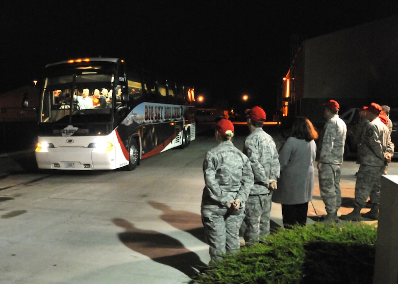 Members of the 219th RED HORSE Squadron wish deploying personnel well as they board a bus bound for Colorado to support flood relief efforts on Oct. 11, 2013.  (U.S. Air Force photo/Senior Master Sgt. Eric Peterson)
