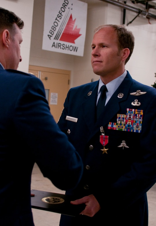 JOINT BASE ELMENDORF-RICHARDSON, Alaska -- Chief Master Sgt. Paul Barendregt, a pararescueman with the Alaska Air National Guard's 212th Rescue Squadron receives the Bronze Star Medal at a ceremony here Dec. 7, 2013. Barendregt was awarded the Bronze Star Medal for his actions during an insurgent attack at Camp Bastion, Afghanistan, on Sept 14, 2012. National Guard photo by Tech. Sgt. Jennifer Theulen.