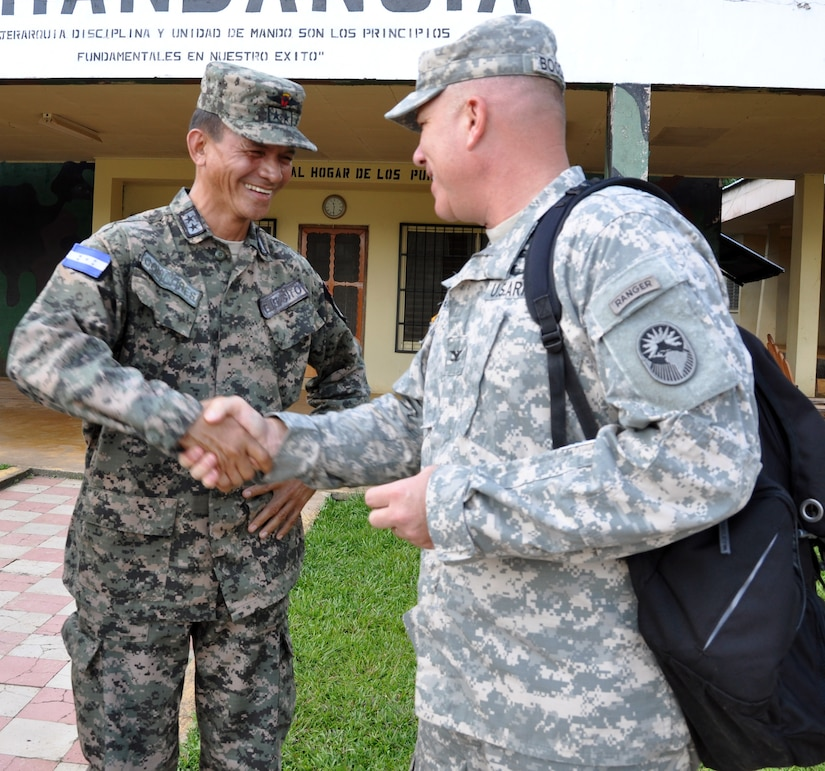 U.S. Army Col. Thomas Boccardi, Joint Task Force-Bravo Commander, and Julie Schechter Torres, Deputy Chief of Mission, U.S. Embassy, met with Lt. Col. Santos Colindres, Deputy Commander of the Honduran 5th Infantry Battalion, at Mocoron, Honduras, Dec. 3, 2013.  The leaders discussed several issues affecting the Gracias a Dios region of Honduras and how the U.S. and Honduras can work together to overcome challenges.  Boccardi and Torres then departed Mocoron to observe Joint Task Force-Bravo's Medical Element (MEDEL) performing a Medical Readiness Training Exercise (MEDRETE) in the remote village of Auka.  At Auka, Boccardi and Torres were able to interact with Honduran medical providers as well as meet with Marilyn Bentlez, Vice-Mayor of Puerto Lempira, Honduras.  (U.S. Air Force photo by Capt. Zach Anderson)