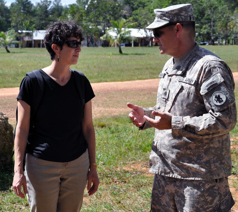 U.S. Army Lt. Col. Alan McKewan discusses the work of the U.S. Southern Command Survey and Assessment Team with Julie Schechter Torres, Deputy Chief of Mission for the U.S. Embassy, during Joint Task Force-Bravo's Culminating Training Exercise (CULEX) at Mocoron, Honduras, Dec. 3, 2013.  More than 90 members of Joint Task Force-Bravo deployed to the Department of Gracias a Dios for the exercise.  (U.S. Air Force photo by Capt. Zach Anderson)